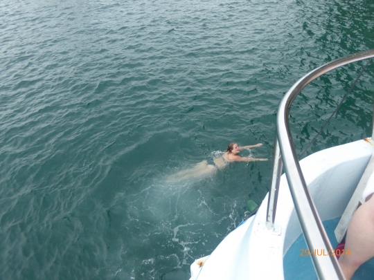 After jumping off the top deck of the boat